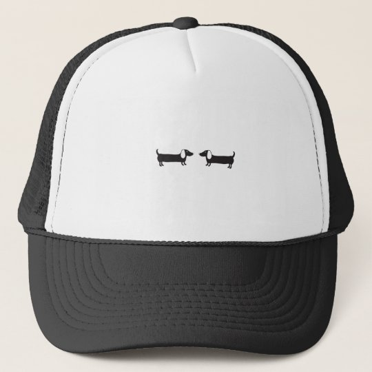 Dachshunds in black and white love trucker hat