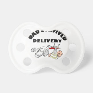 Dad and beautiful baby son pacifier