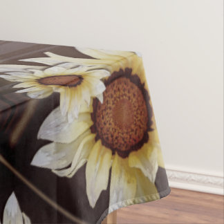 Daisies on brown tablecloth