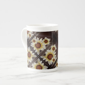 Daisies on brown tea cup