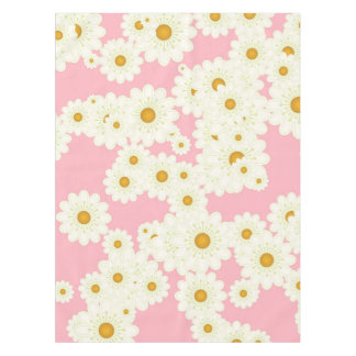 Daisies on pink tablecloth