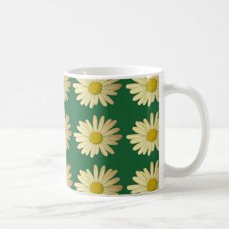 Daisy flowers on a green lawn coffee mug