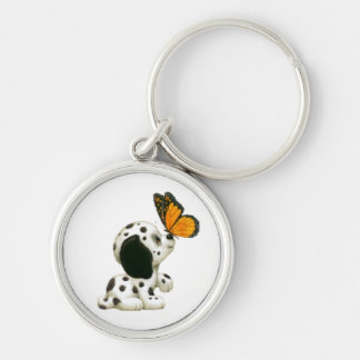 Dalmatian puppy with butterfly keychain