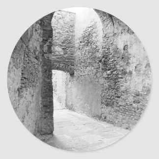 Dark corridors of an old fortification structure classic round sticker
