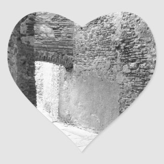 Dark corridors of an old fortification structure heart sticker