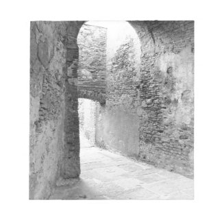 Dark corridors of an old fortification structure notepad