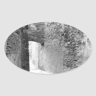 Dark corridors of an old fortification structure oval sticker