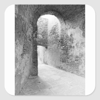 Dark corridors of an old fortification structure square sticker