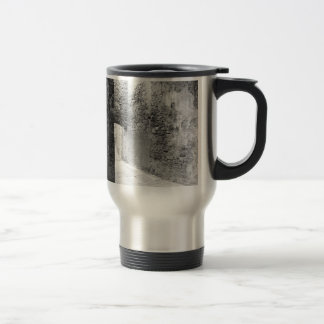 Dark corridors of an old fortification structure travel mug
