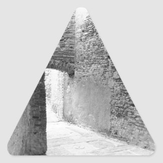 Dark corridors of an old fortification structure triangle sticker