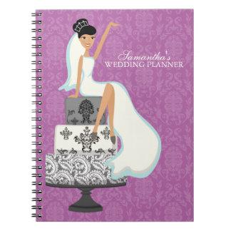 Dark Haired Bride on Wedding Cake orchid Spiral Notebook