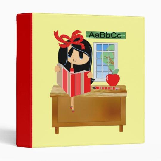 Dark Haired Girl at School Desk Reading Binder