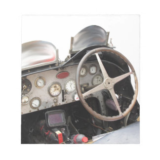 Dashboard and steering wheel of classic sport car notepad