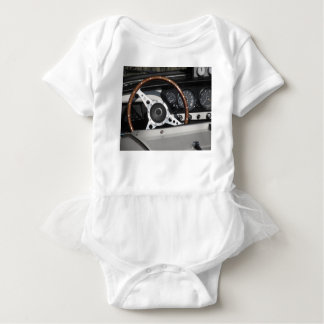 Dashboard of an old british classic car baby bodysuit