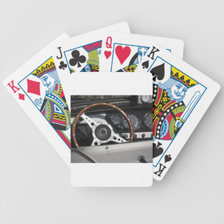 Dashboard of an old british classic car bicycle playing cards