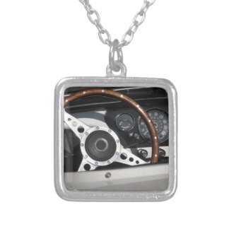Dashboard of an old british classic car silver plated necklace