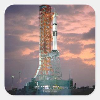 Dawn breaks behind ASTP Saturn IB CDDT Square Sticker