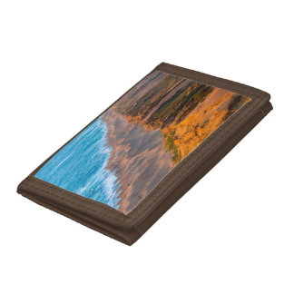 Days Last Light Strikes The Sandy Shore Of Point Trifold Wallet