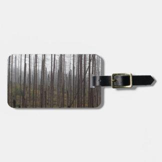 Death spruce trees luggage tag
