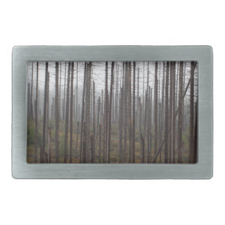 Death spruce trees rectangular belt buckles