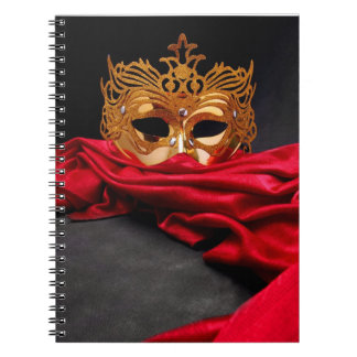Decorated mask for masquerade on red velvet note books