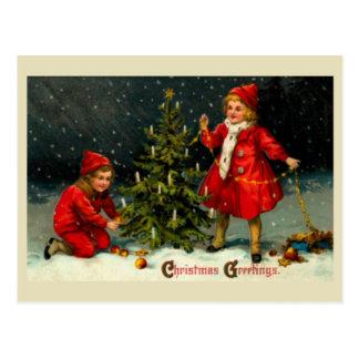 Decorating the Christmas tree-kids Postcard