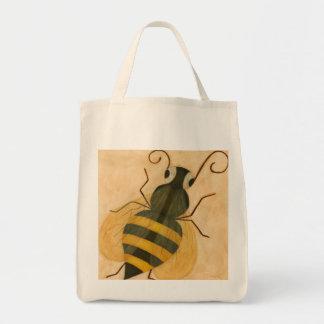 Décrivez un sac d'épicerie organique d'abeille de