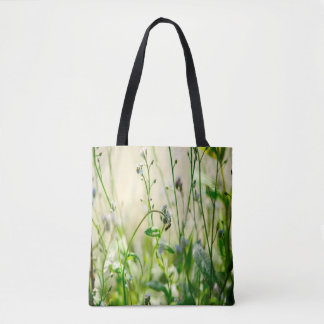 Deep down in a floral summer meadow forget-me-not tote bag
