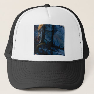 deep vertical cracks in rock trucker hat