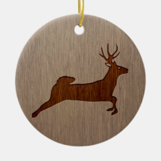 Deer silhouette engraved on wood design round ceramic ornament