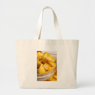 Defocused and blurred image of dry corn flakes large tote bag