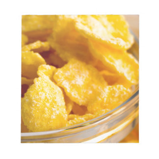 Defocused and blurred image of dry corn flakes notepad
