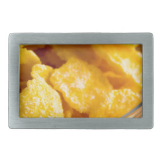 Defocused and blurred image of dry corn flakes rectangular belt buckle
