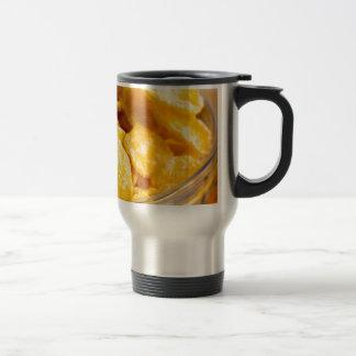 Defocused and blurred image of dry corn flakes travel mug