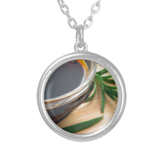 Defocused and blurred image of soy sauce silver plated necklace