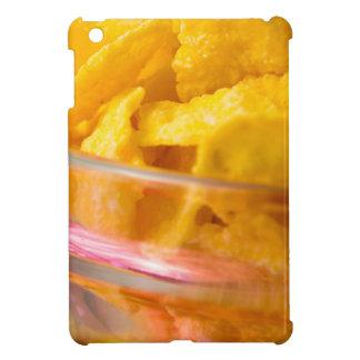 Defocused and blurred macro view of yellow flakes iPad mini cases