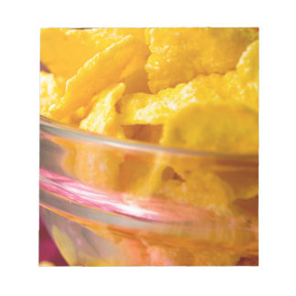 Defocused and blurred macro view of yellow flakes notepads