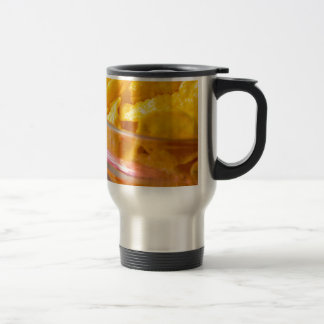 Defocused and blurred macro view of yellow flakes travel mug