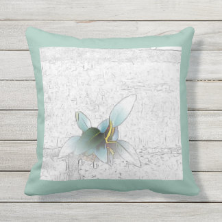 Delicate green plant on pale teal background outdoor pillow