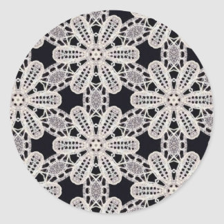 Delicate lace fabric patterns in black & white round sticker
