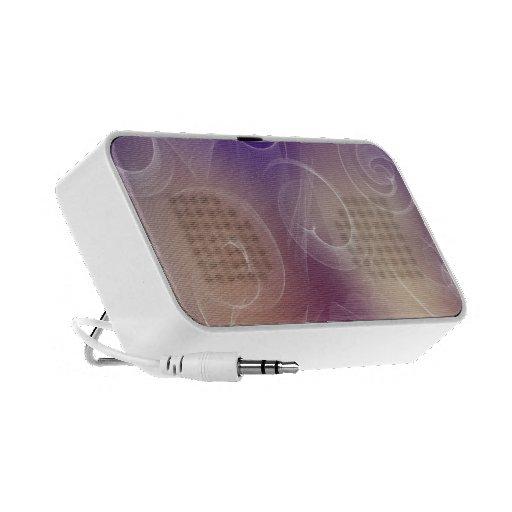 delicate swirls on purple and beige background laptop speaker