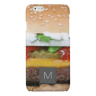 delicious cheeseburger with pickles photograph