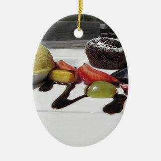 Delicious molten chocolate cake with fresh fruit ceramic ornament