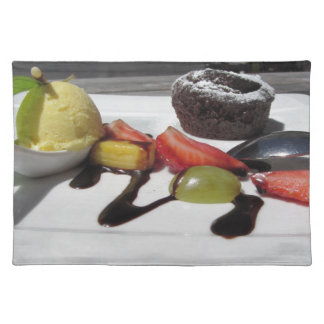 Delicious molten chocolate cake with fresh fruit placemat