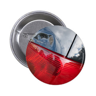 Dented tailgate pinback buttons