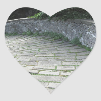 Descent stone walkway of medieval bridge heart sticker
