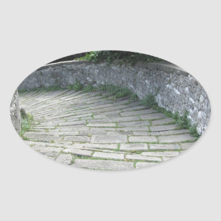 Descent stone walkway of medieval bridge oval sticker