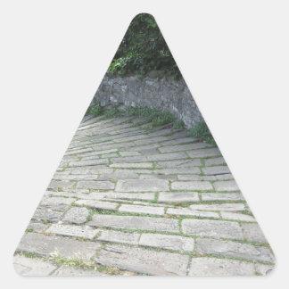 Descent stone walkway of medieval bridge triangle sticker