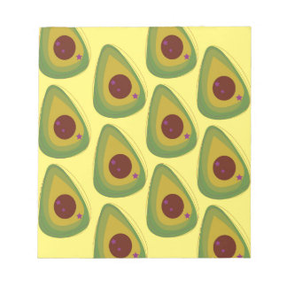 Design avocados on gold notepad