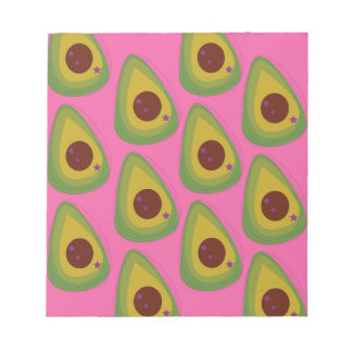 Design avocados on pink notepad